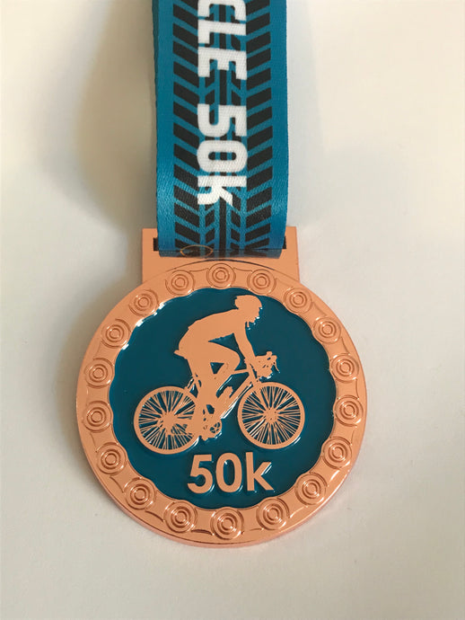 Cycle 50k rose gold medal