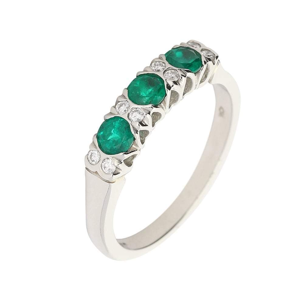 Christopher Wharton Ring Wharton platinum three stone Emerald ring with complimenting diamonds