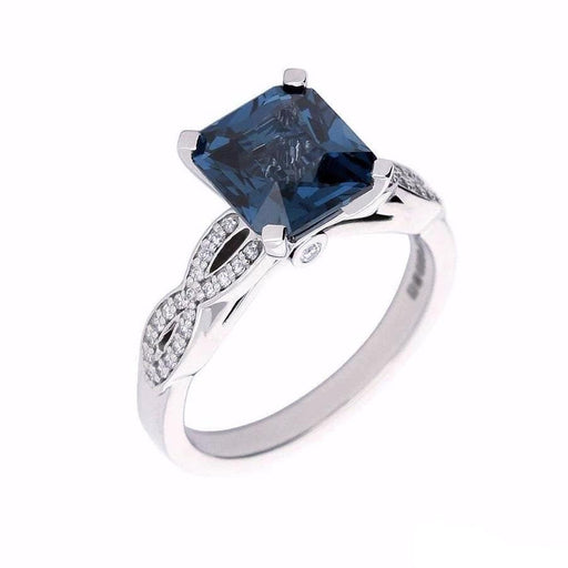 Rock Lobster Ring Palladium weaved shape ring set with a petrol blue spinel and diamonds