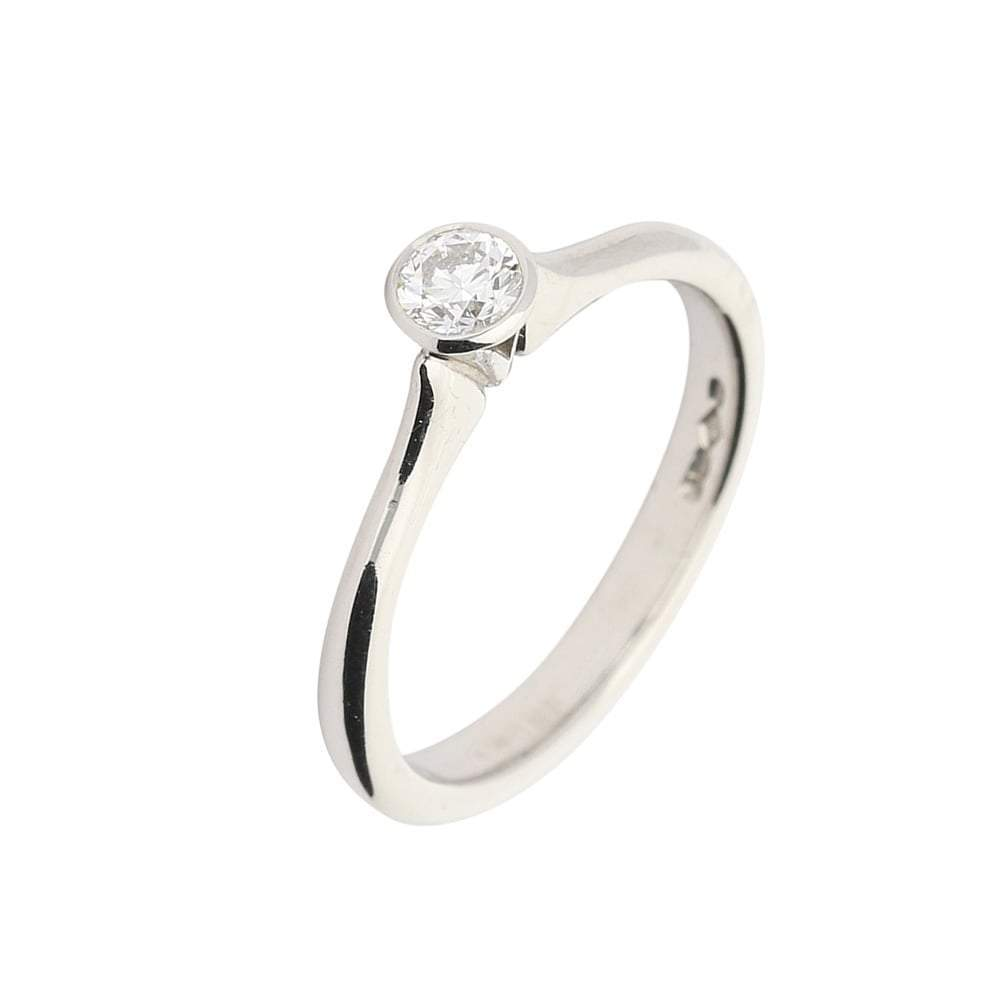 Rock Lobster Ring Platinum brilliant cut diamond ring with rubover setting