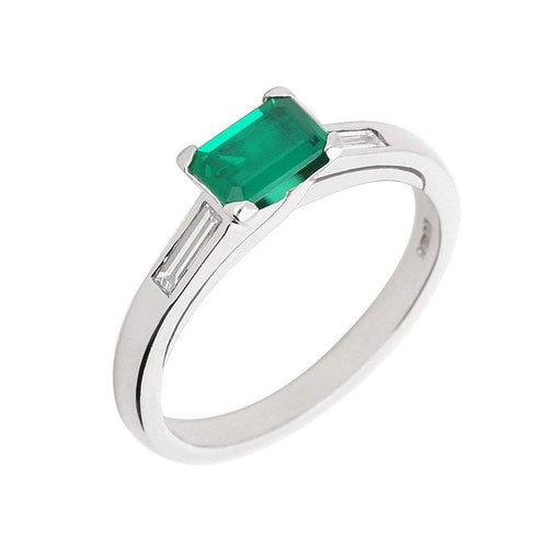 Wharton platinum emerald ring with two side baguette diamonds