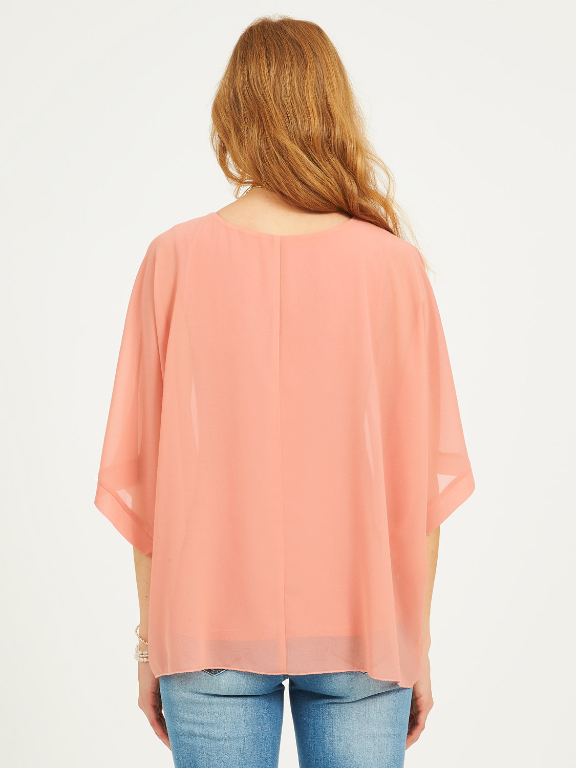 Cape Sleeves And Knit Blouse