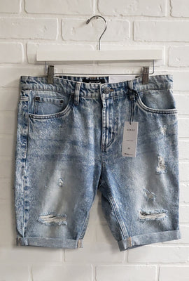 Short en denim mince à effet Destruction