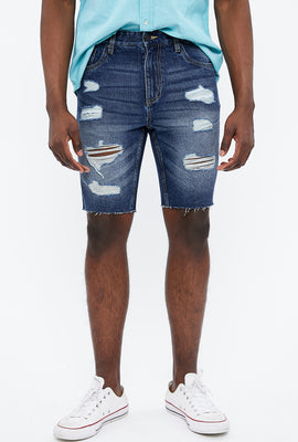 Short en denim détruit à coupe slim