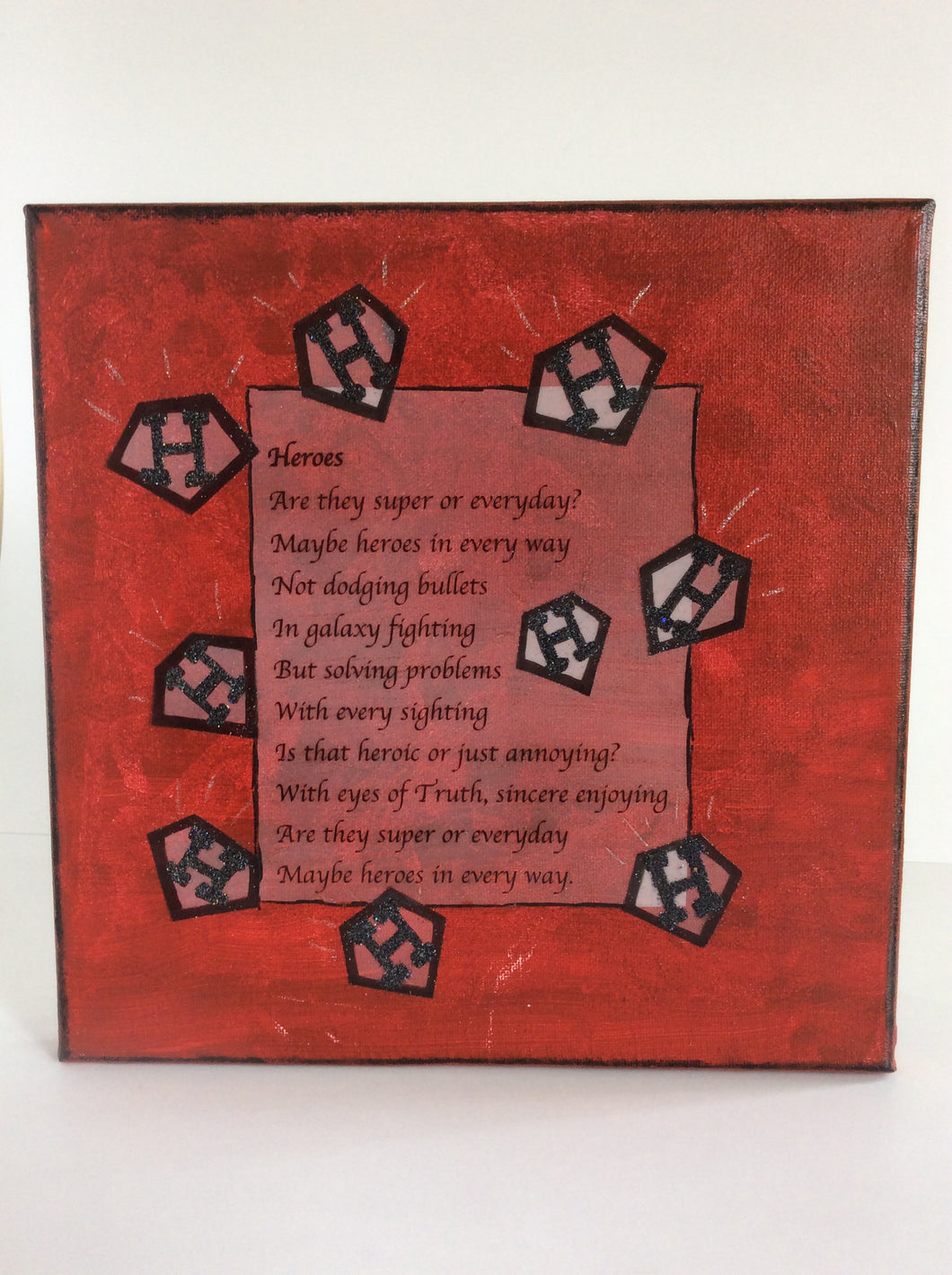 Heroes is an original poem on canvas shown in red from poempieces.com