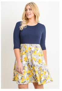 Curvy -A 3/4 Sleeve Skater Scoop Neck Flare Dress with Floral Detail & Solid Color Bodice