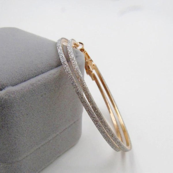 Sparkly Gold Tone Hoop Earrings 2.25""