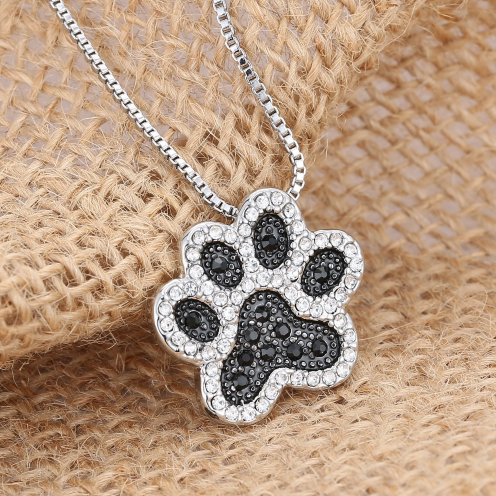 crystal dog paw pendant