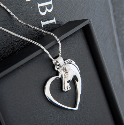 hollow heart horse pendant