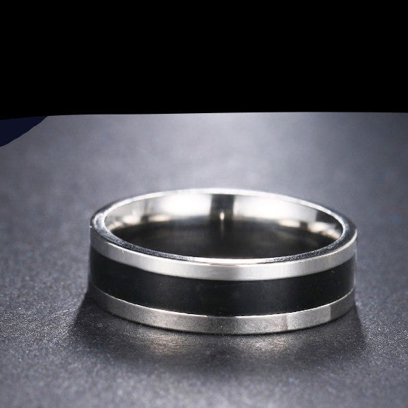 black and silver stainless steel ring