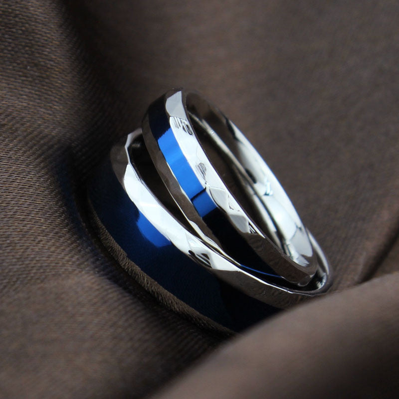 silver and blue ring