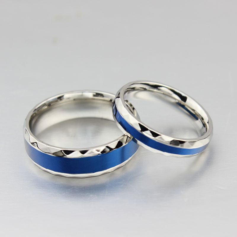 silver and blue titanium steel ring