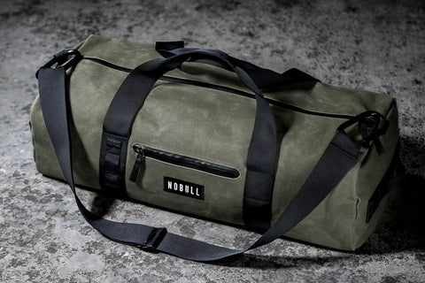 WAXED CANVAS TRADITIONAL DUFFLE (ARMY)