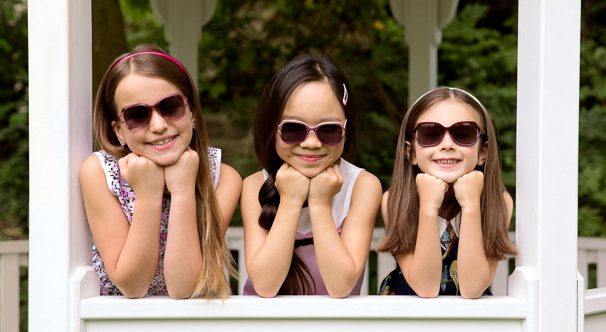 three cute preppy girls posing in a white gazebo wearing sassy polarized butterfly style sunglasses in 3 different colors