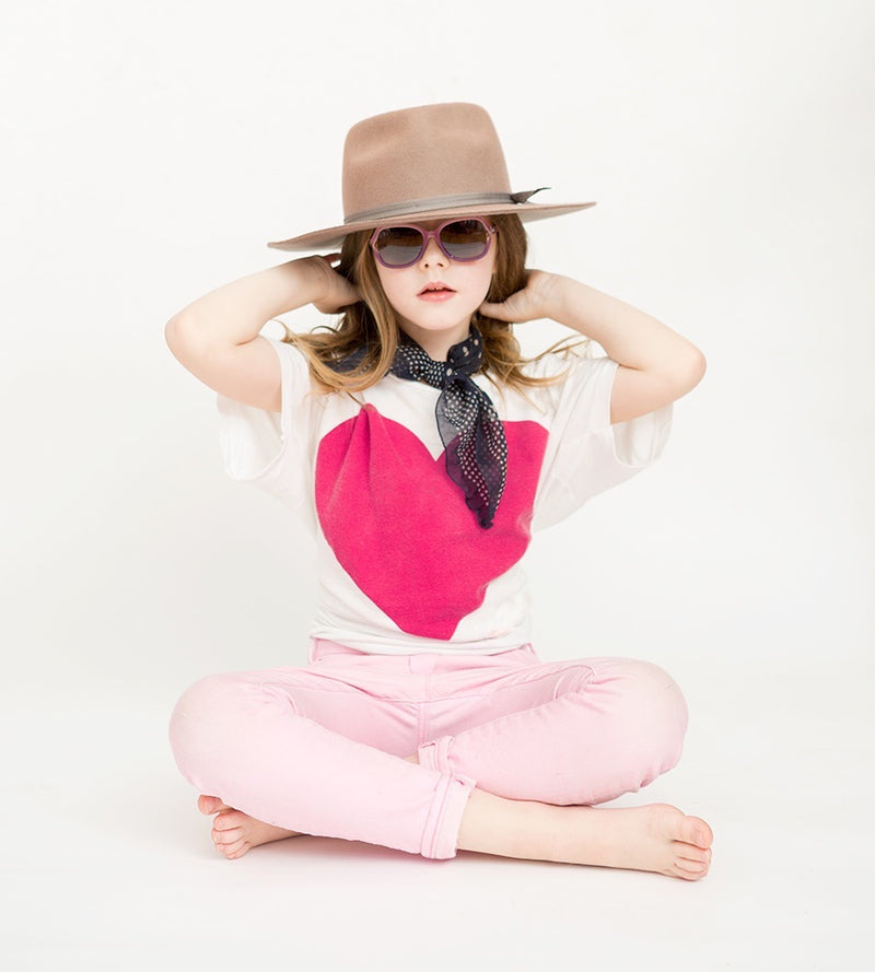 cute girl wearing pink toucca kids butterfly avery girls sunglasses perfect for ages 2 to 6