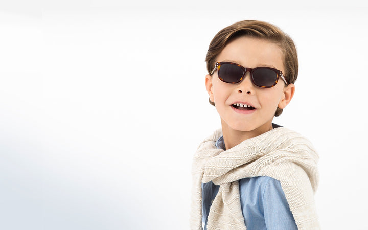 preppy boy wearing blonde havanna classic kids sunglasses perfect for ages 2 to 6