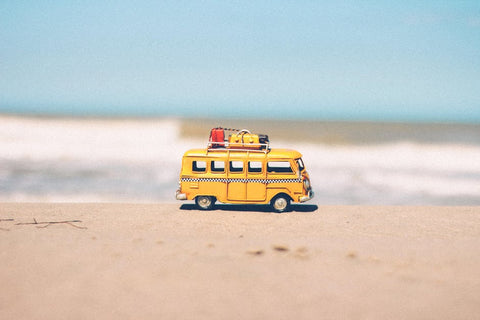 little yellow bus on beach - toucca kids top 10 must haves with kids travel