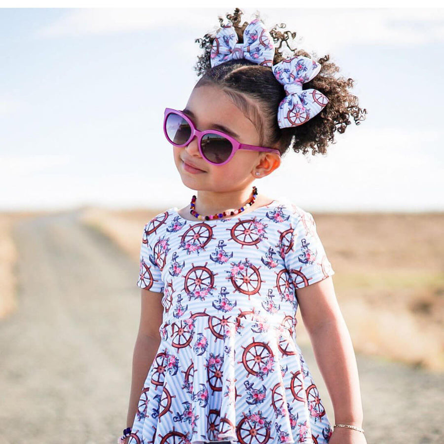 Cute little girl wearing awesome pink polarized cat eyes sunglasses that looks best for kids