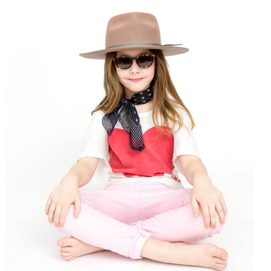 toucca kids blonde havana best childrens sunglasses with uv protection little girl sitting cross legged
