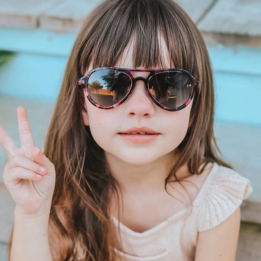 toucca kids pink tortoise best girls polarized aviator sunglasses little girl giving peace sign