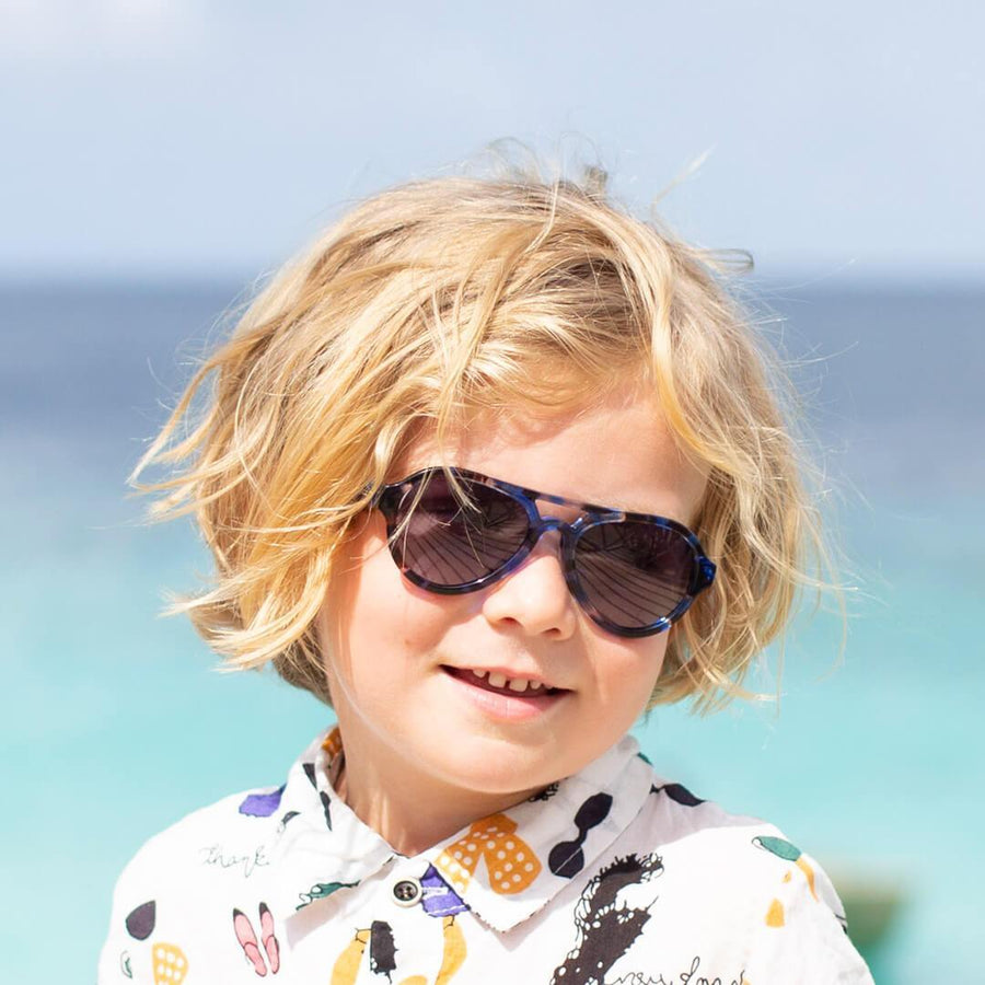 toucca kids blue tortoise polarized kids sunglasses - little boy by the beach