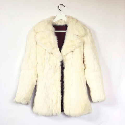 Elegant white rabbit fur coat