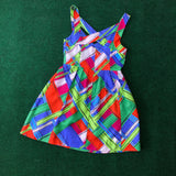 Brightly colored criss cross silk party dress