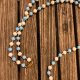 Long blue and white beaded necklace