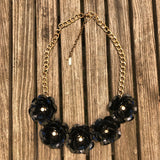 Black plastic flowers with chain