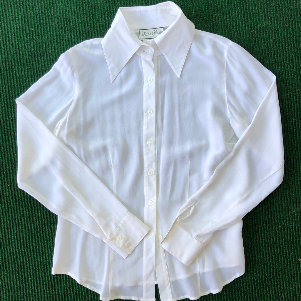 White silk blouse with pointed collars
