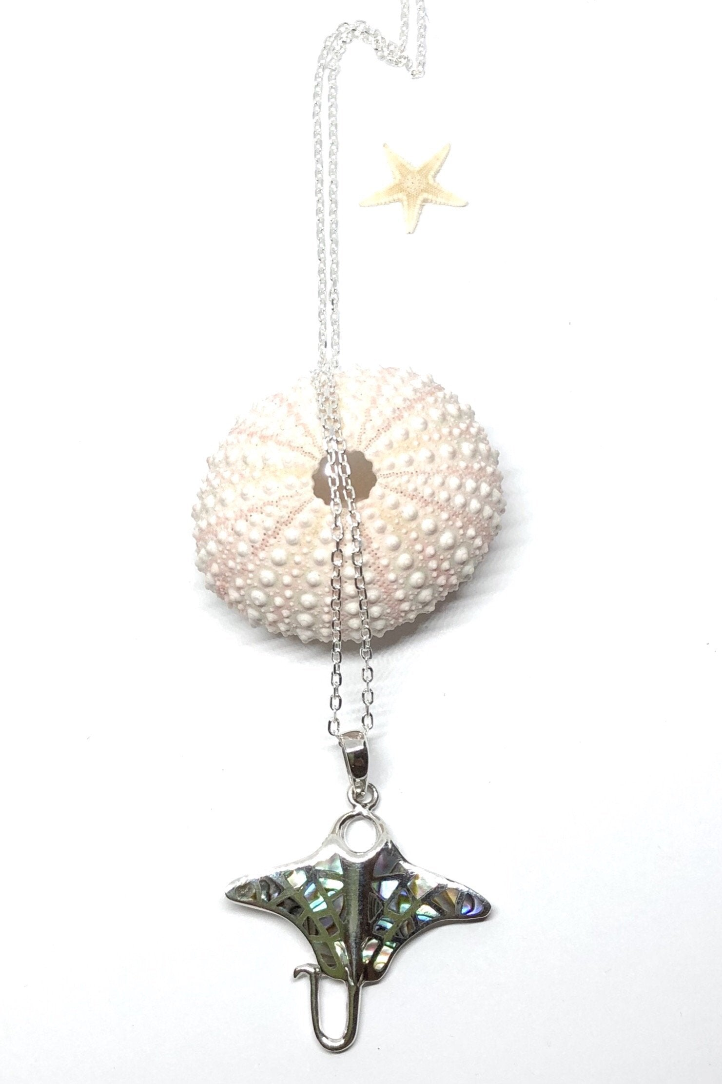 Necklace Cay Manta Ray with paua shell. A perfect pendant so beautifully inlaid with the spots of Paua shell on its wings