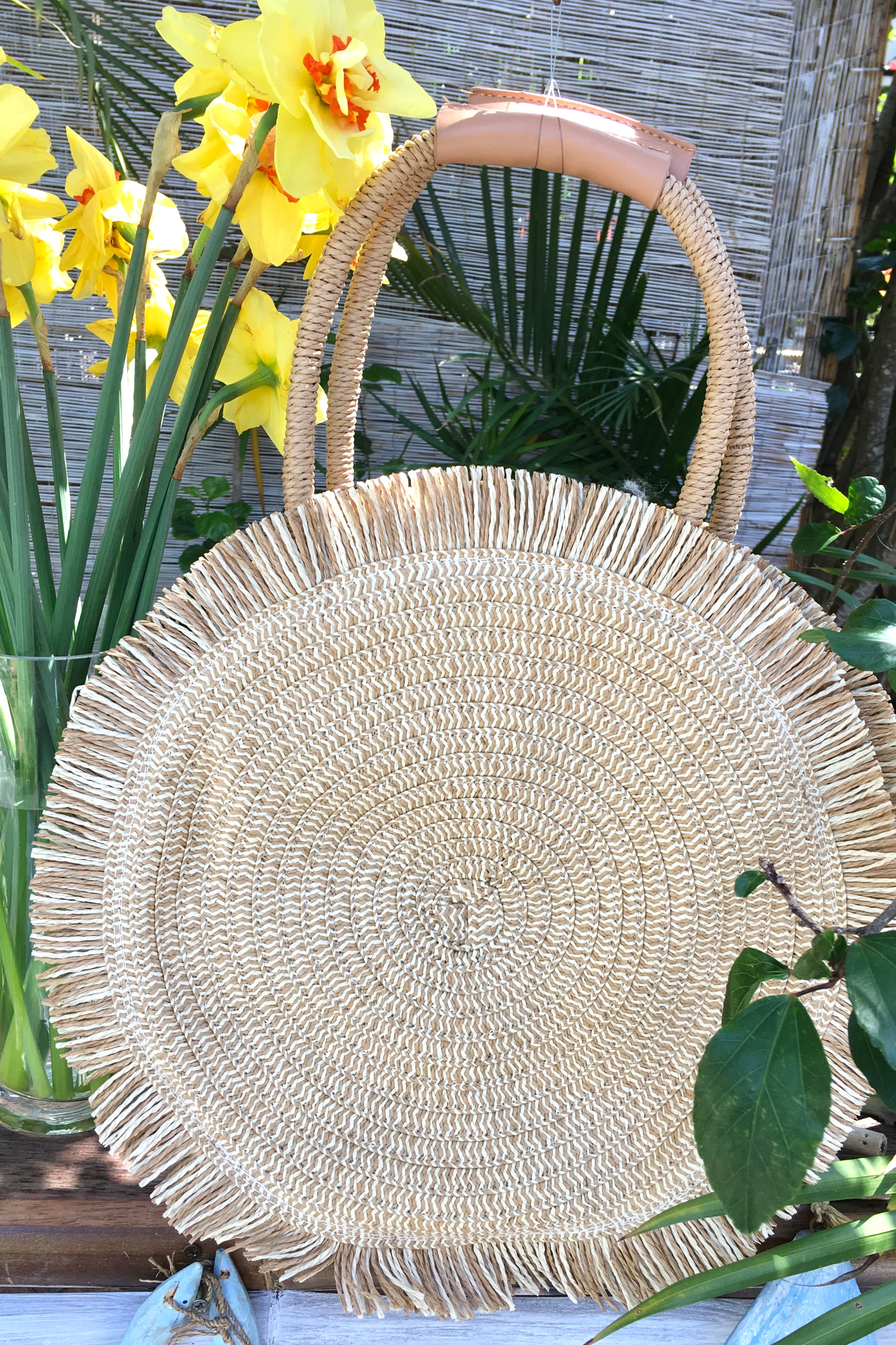 The Bag Lillie Grass Sunbeam is a stunning and luxurious woven circular bag, big enough for all many things whilst not being bulky