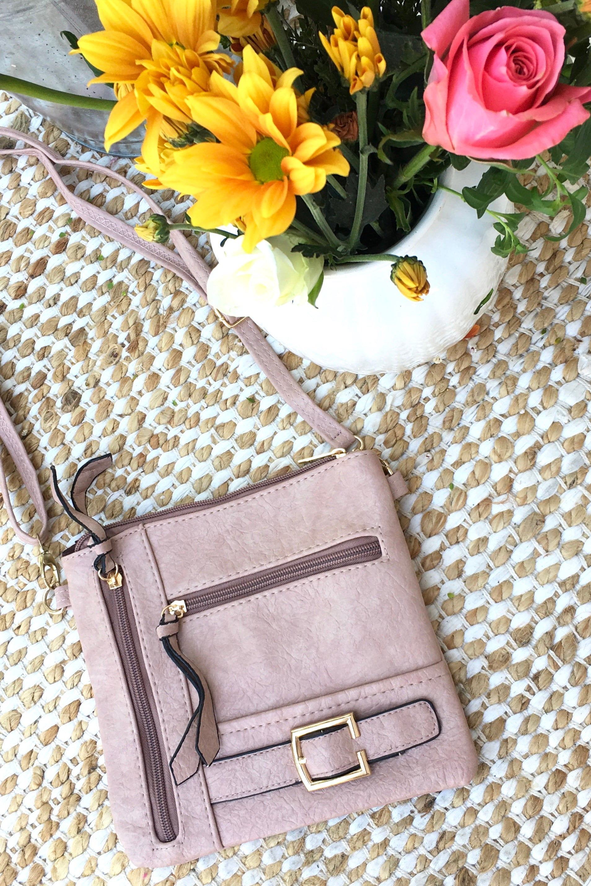 Bag Yeah Cross Body in a neutral blush colour, vegan leather with adjustable strap, miniature crossbody bag perfect for evening wear.