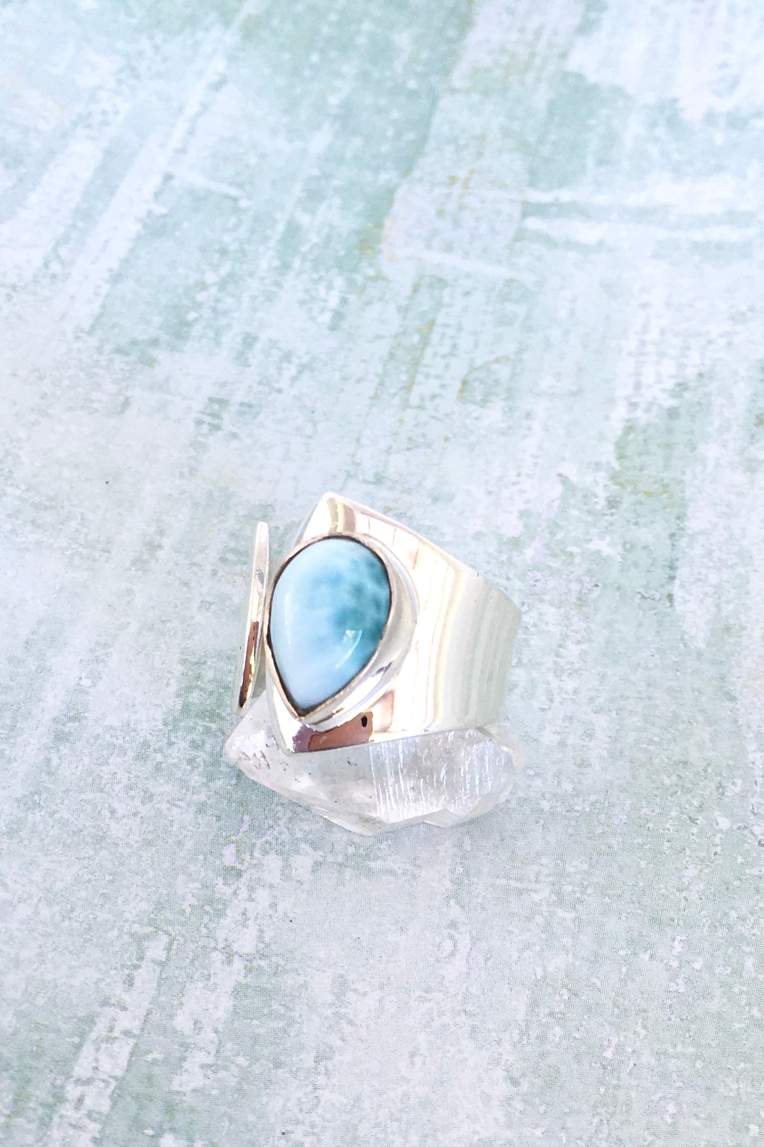 Oracle Larimar Ring. Oval cut blue topaz Larimar stone ring, Sterling silver setting and ring band.