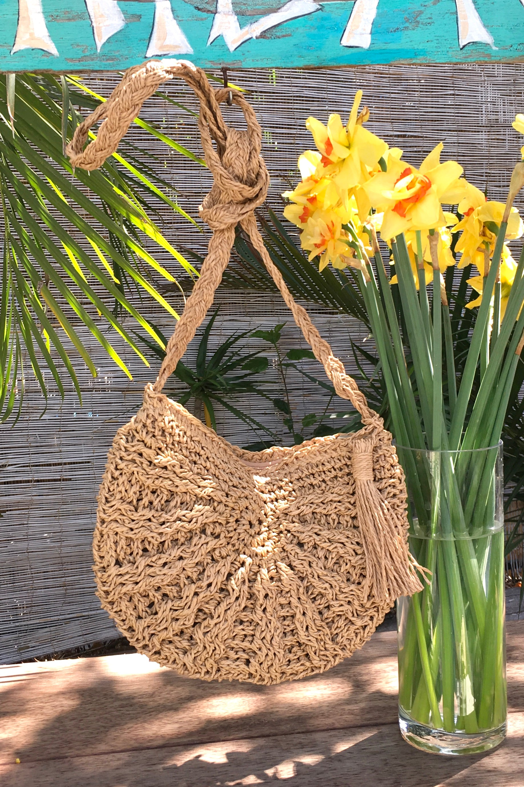 the perfect little woven straw shoulder bag to hold your phone, wallet, keys