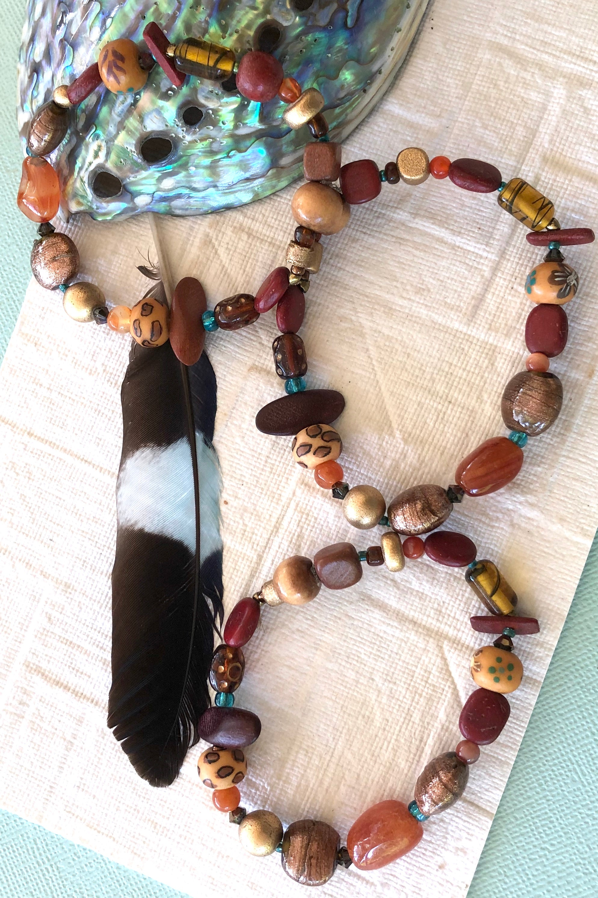 Bracelet Cay Afriki Wood has a powerful and earthy vibe and the beads include antique glass, Carnelian, wood, crystal, glass lamp work beads and hand painted wood beads.