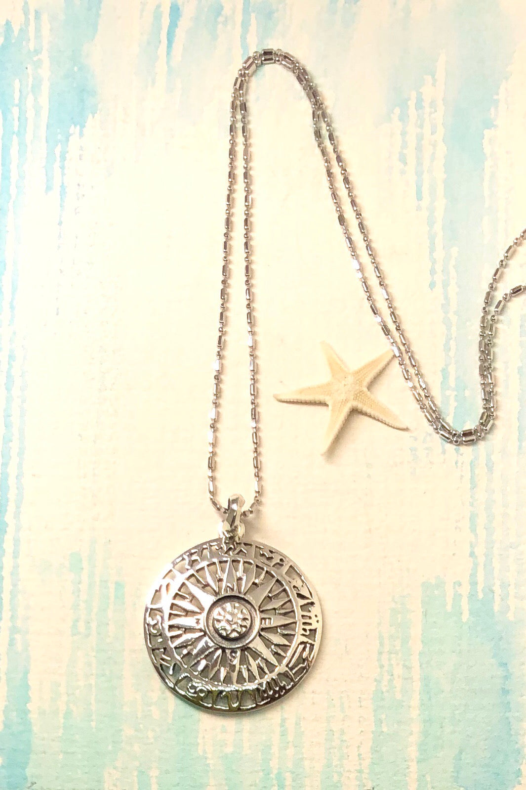 This solid silver Astro Compass pendant comes on a fine silver chain.