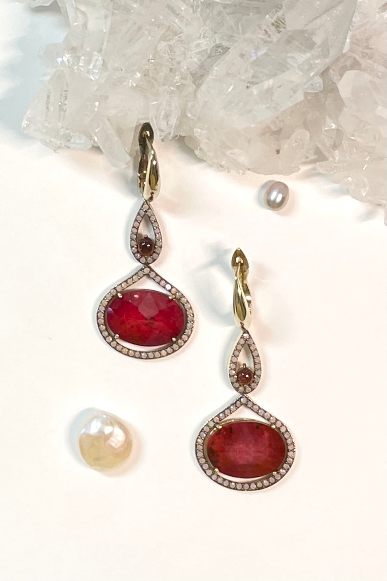 earrings are made from a faceted conceptual doublet made with a sliver of Ruby gemstone with rock crystal applied to the top give depth and sparkle.