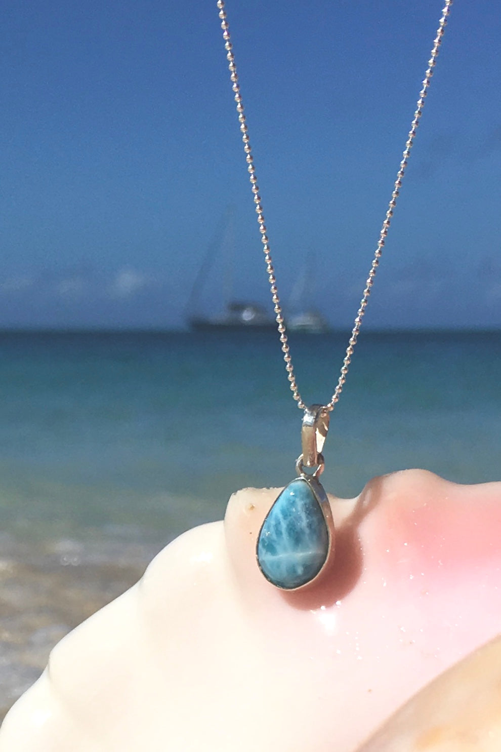Pendant Larimar Blue Pebble on a silver chain, gemstone necklace in soft blue colour.