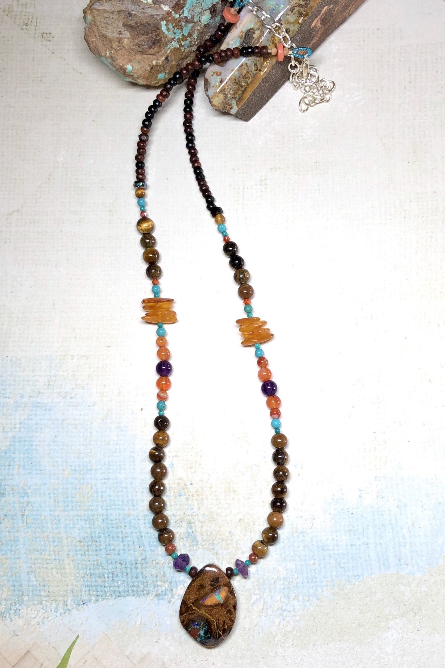 A powerful gemstone necklace with natural stones. Perfect to wear with chic boho luxe clothing an exclusive design