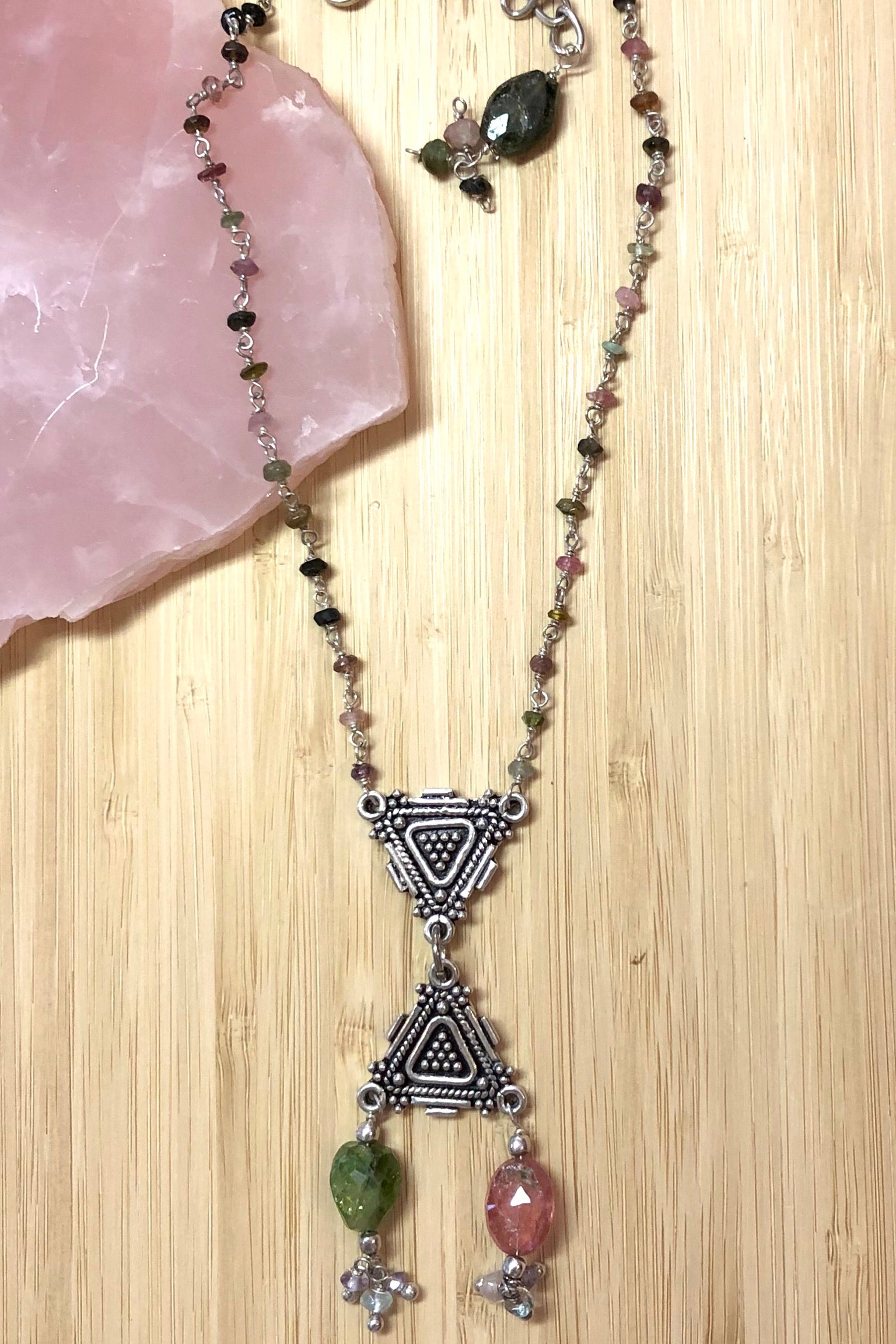 The Necklace Echo Tourmaline tangle has been designed using a variety of different coloured tourmaline gemstone beads and a Thai Silver centre piece.
