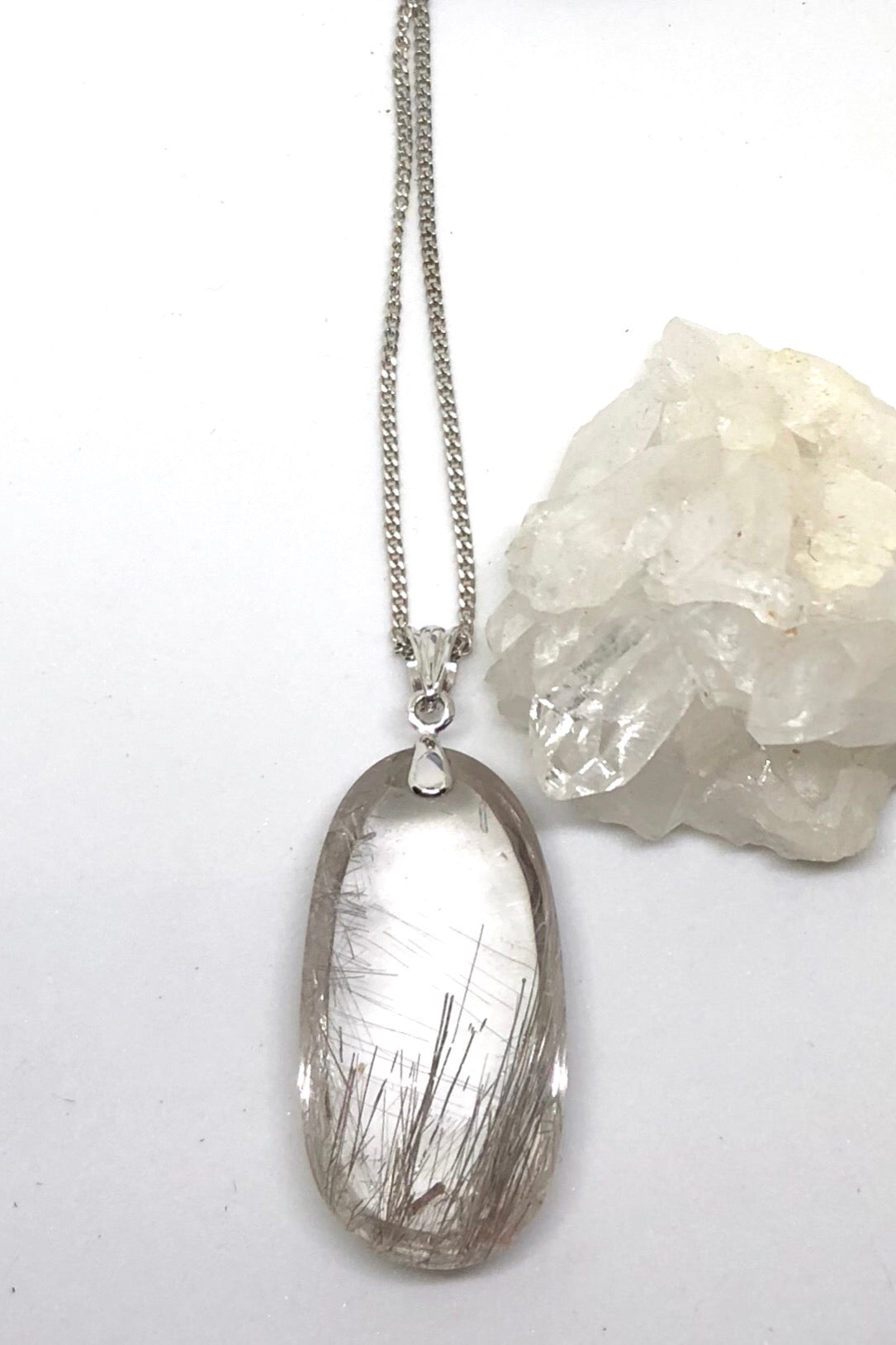 Pendant of Rutilated Quartz Crystal on a Silver Chain 3