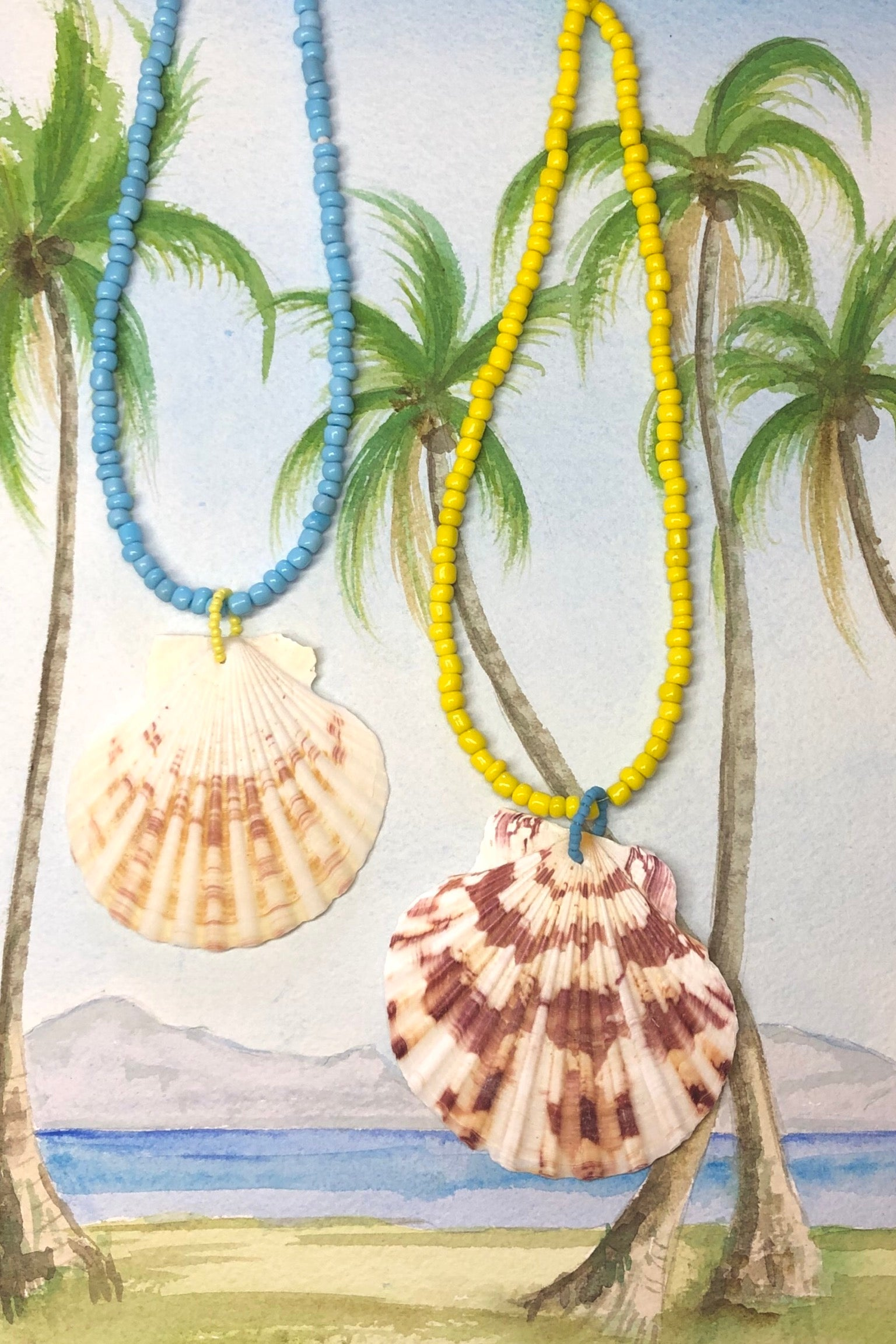 these collected sea shells all carry different patterns, no two ever alike and you can swim in this! its strung on the brightest happy glass beads.
