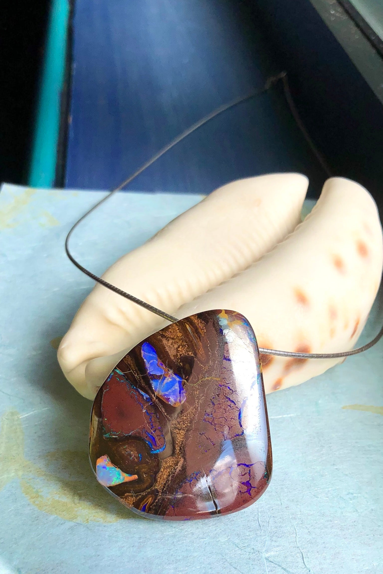 this intriguing piece of Boulder Opal was mined, cut and polished in Queensland. The flashes of colour give one a glimpse into the past.