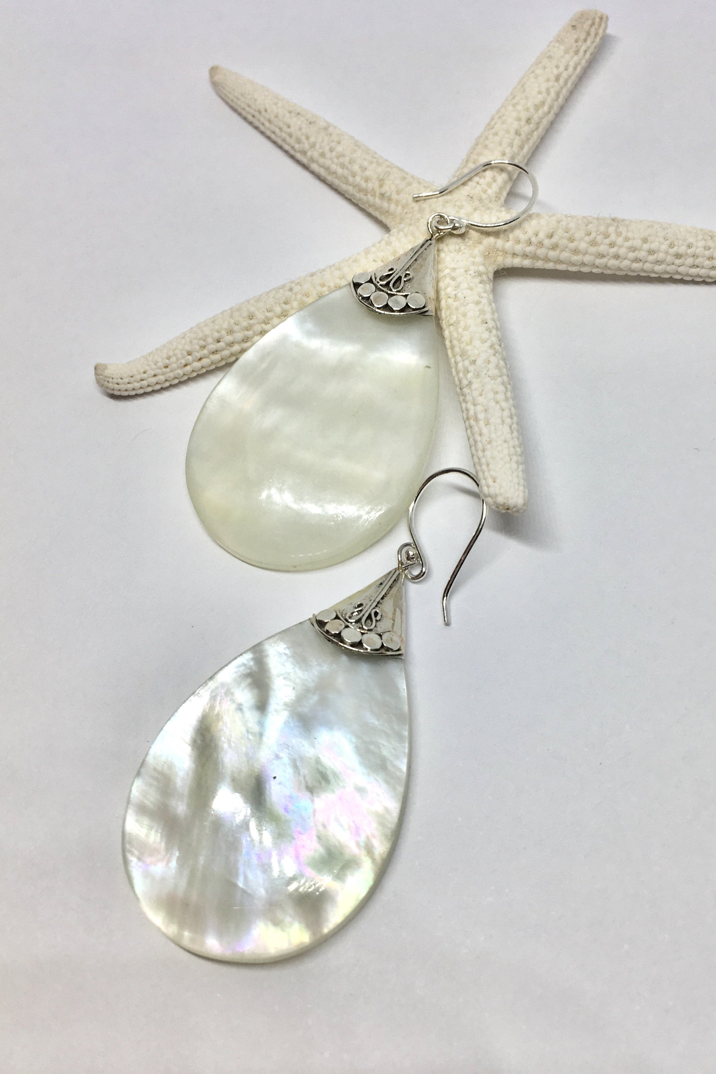 Mother of Pearl teardrop style earrings with 925 solid silver detailing
