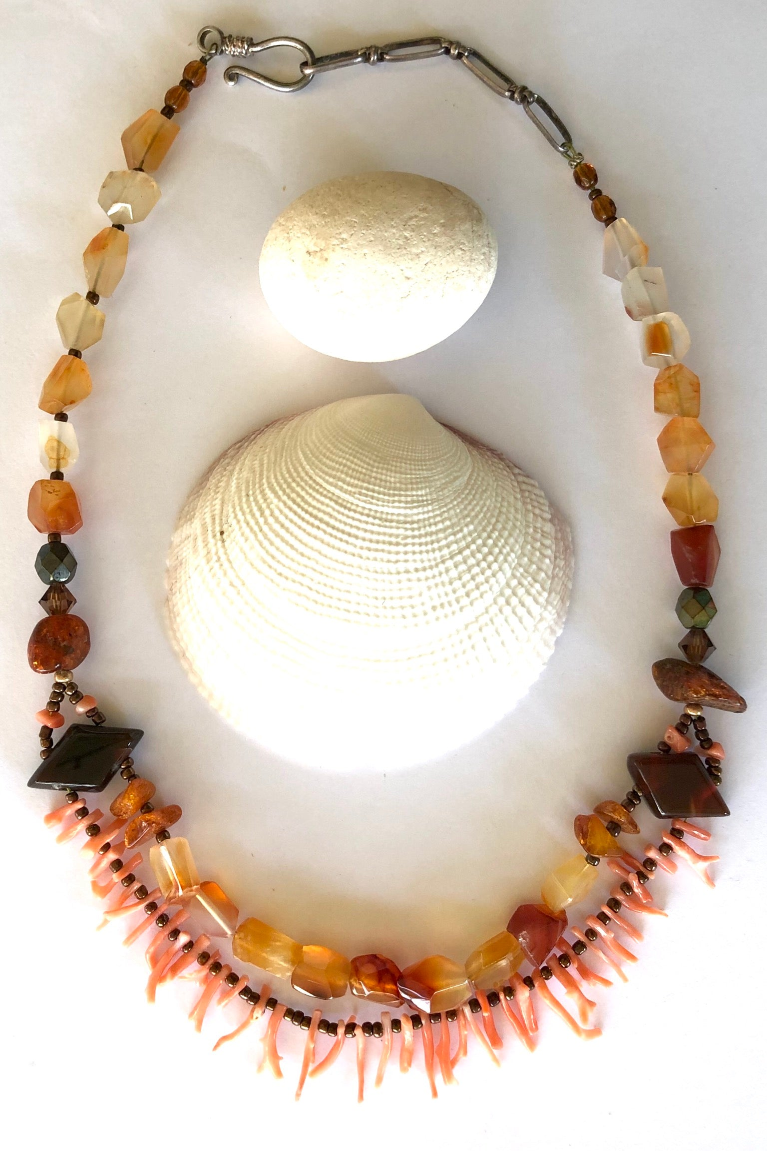 Necklace Cay Coral and Carnelian features beautiful village cut stones inculding Carnelian, Branch Coral, Amber and crystal beads.