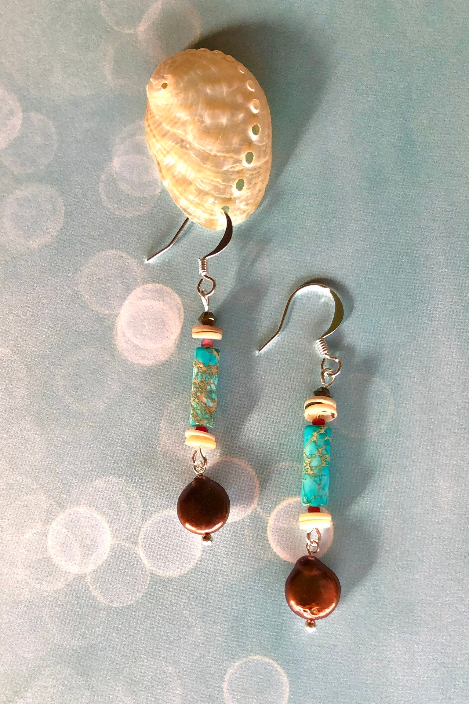 Samara May bronze pearl earrings are handmade drop style earrings  featuring turquoise Howlite, shell bead, crystal, bronze coloured pearl and those stones are village cut.