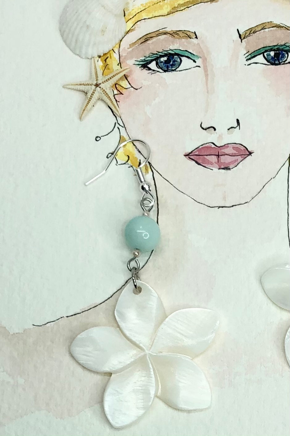 these earrings with frangipani flowers hand carved from Mother of Pearl shell all carry the distinctive marks of the artist who created them,
