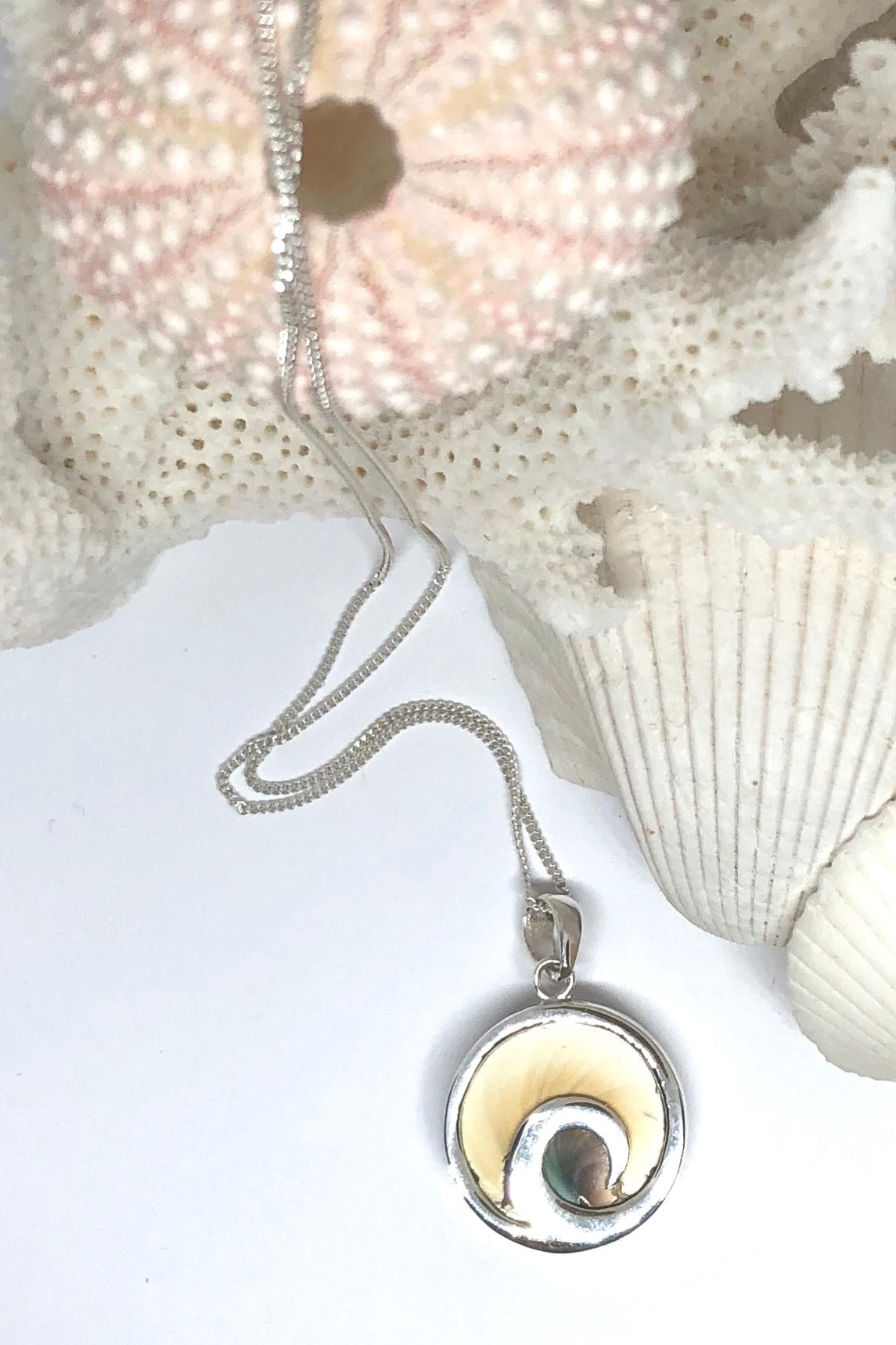 This darling Pendant Shiva Shell, known as the third eye, comes on a 925 silver chain, featuring approximate 2cm in length, 925 solid silver surround, delicate little round Shiva shell design.