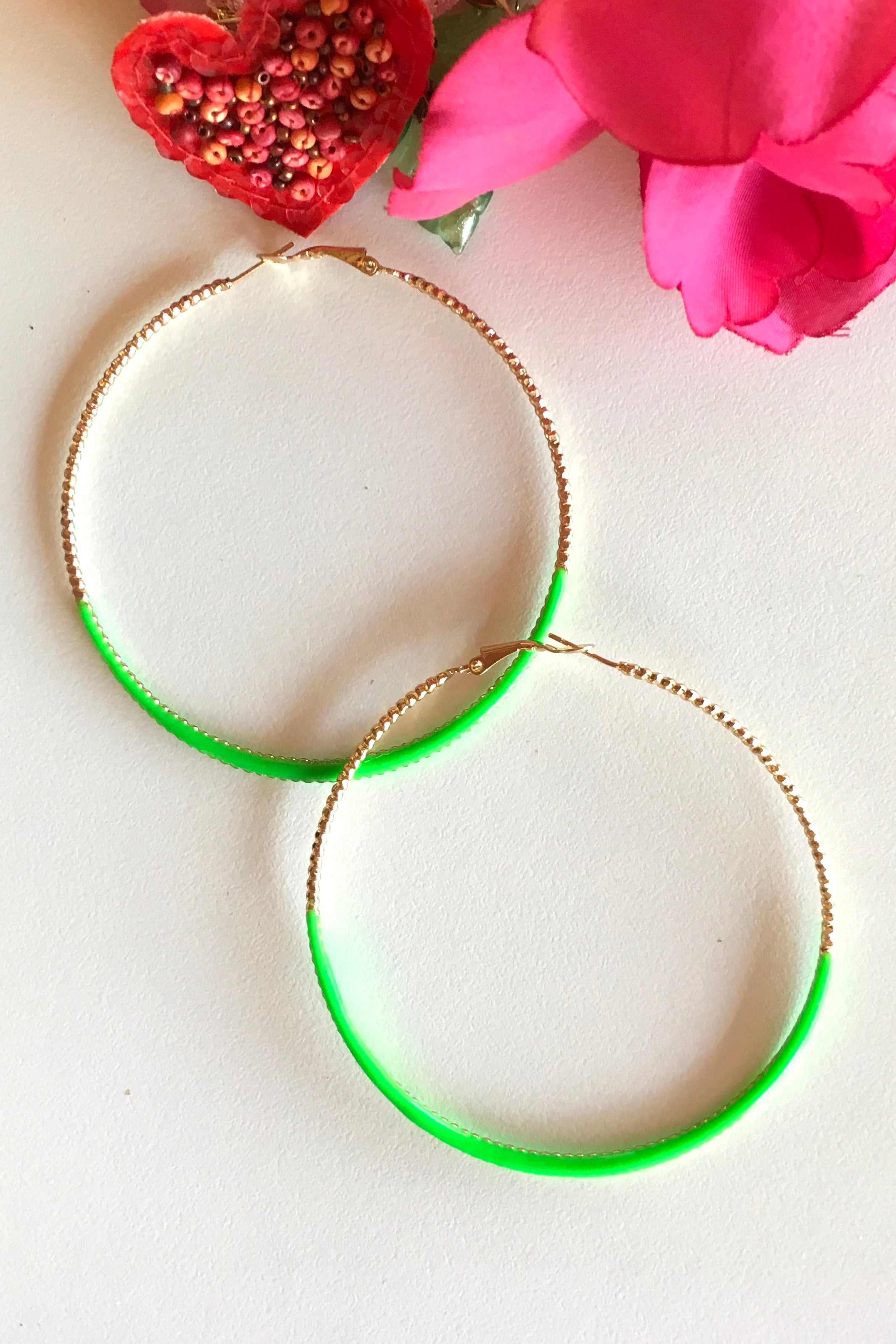 These retro gold hoops are sure to make a statement! Dipped in a splash of colour to accentuate any outfit!